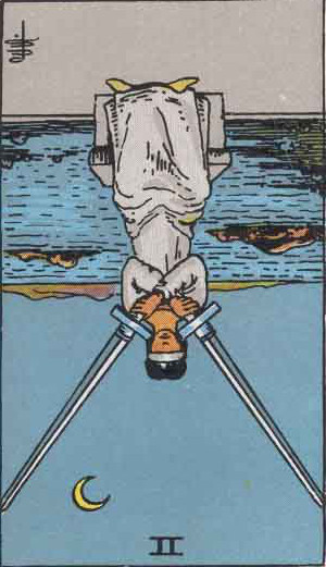 The Reversed Two Of Swords Tarot Card From The Rider-Waite Tarot Deck.