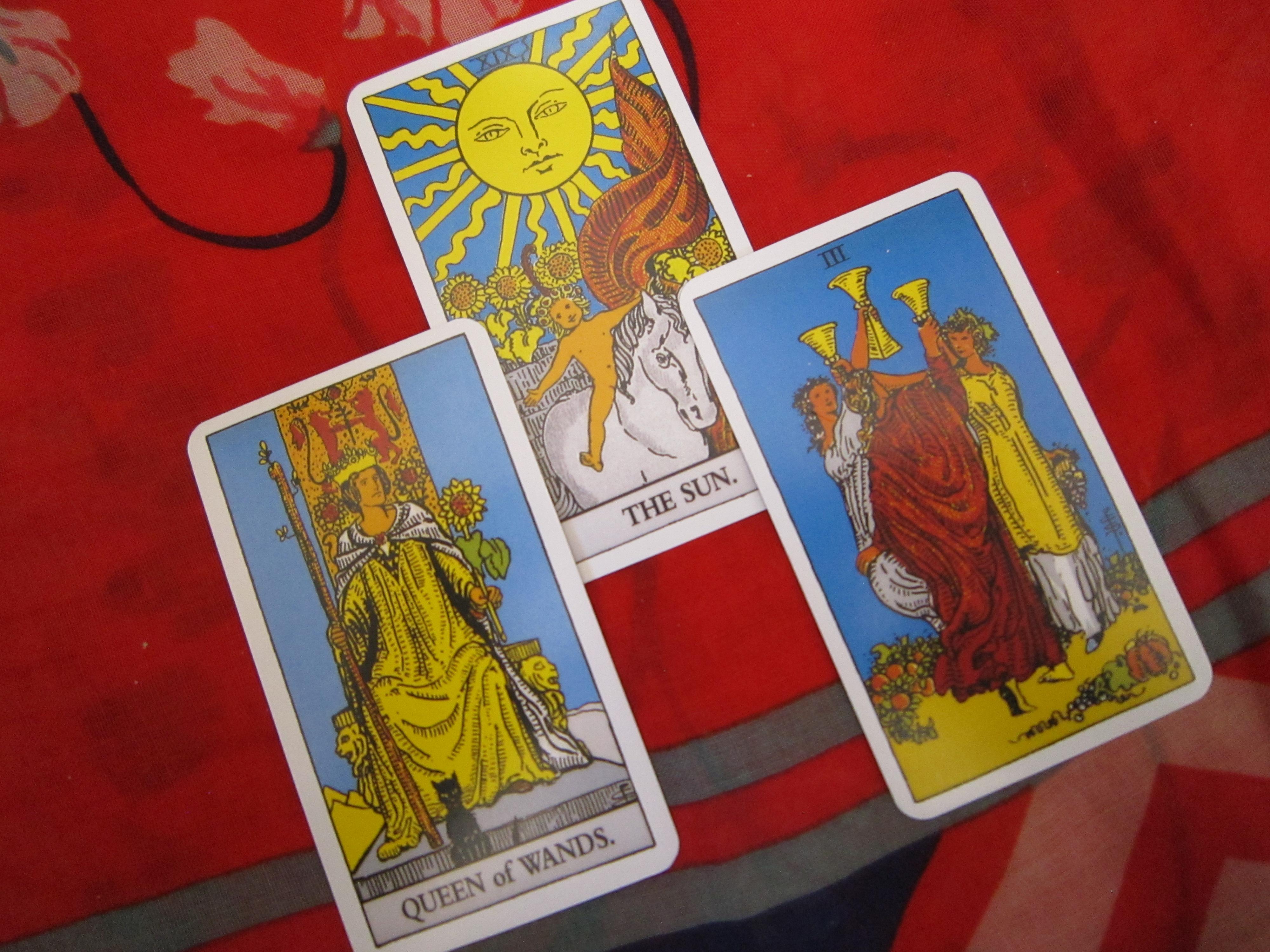 Three tarot cards displayed during a tarot reading.