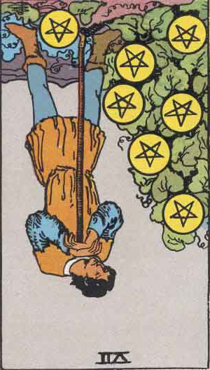 The Reversed Seven Of Pentacles Tarot Card From The Rider-Waite Tarot Deck.