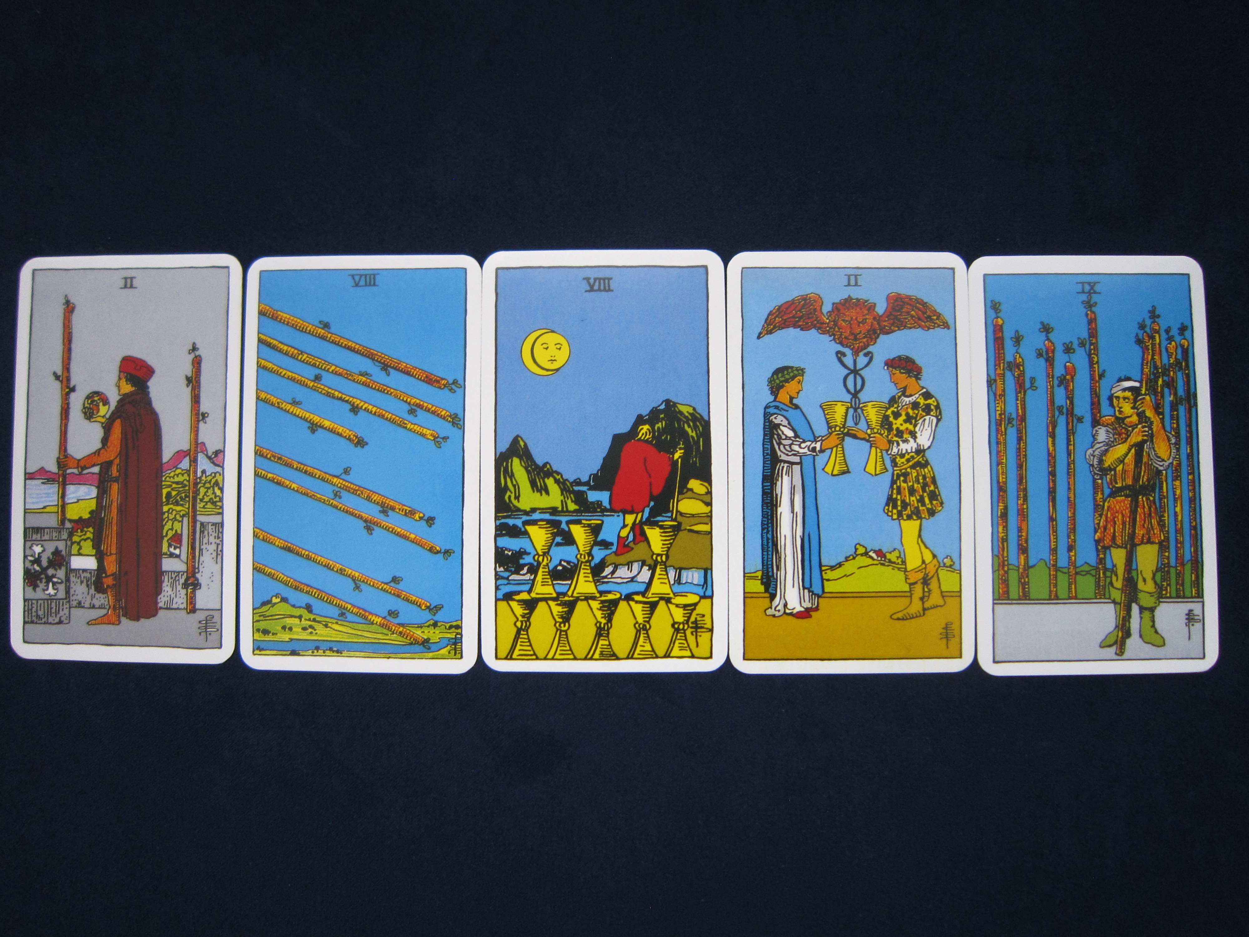 Five card tarot reading with the two of wands, the eight of wands, the eight of cups, the two of cups and the nine of wands.