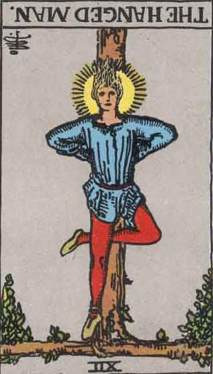 The Reversed Hanged Man Tarot Card From The Rider-Waite Tarot Deck.