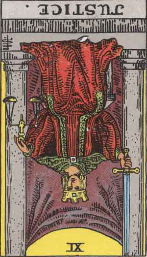 The Reversed Justice Tarot Card From The Rider-Waite Tarot Deck.